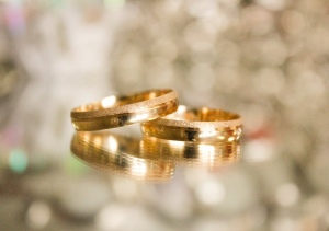Two gold wedding rings on top of each other
