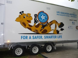 Harold the giraffe picture on a truck, safer, smarter