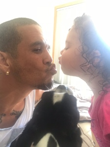 Daddy kissing his daughter. Man kissing his pretty princess. He loves her too much